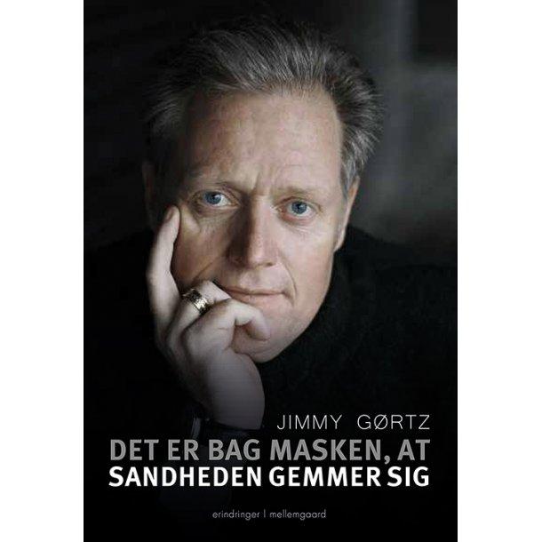 DET ER BAG MASKEN, AT SANDHEDEN GEMMER SIG